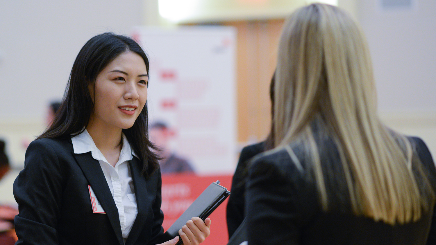 students networking at a meet the firms event