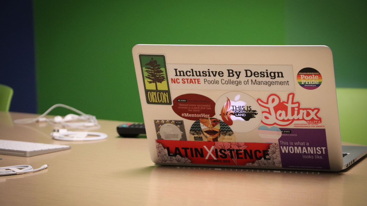 Laptop with Inclusive by Design Stickers