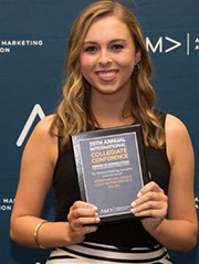 Photo of Lauren Brommer, NCState AMA chapter president for 2016-17, with the Chapter Excellence Award