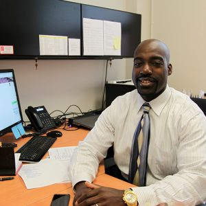 Photo of Ayo Agunbiade in his office at the NC State Jenkins MBA program