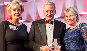 Photo of Ken Torok, center, with Poole College Dean Annette L. Ranft, right, and Paige Allen Harris, president, NC State Alumni Association, left.