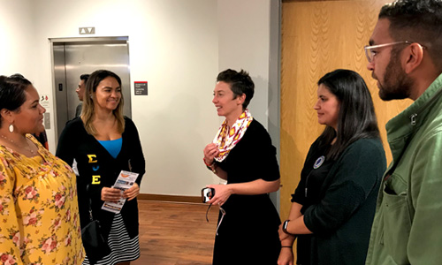 Dakota Lowry, Chelsea Locklear and Tayah Butler, Poole College Diversity and Inclusion director, talked with Locklear's friends after the unveiling of the display at Poole College.