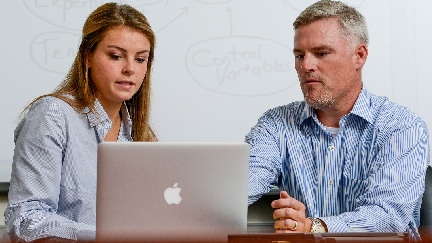 Photo of Sadie Rockefeller and Joe Brazel in discussion about a research project.