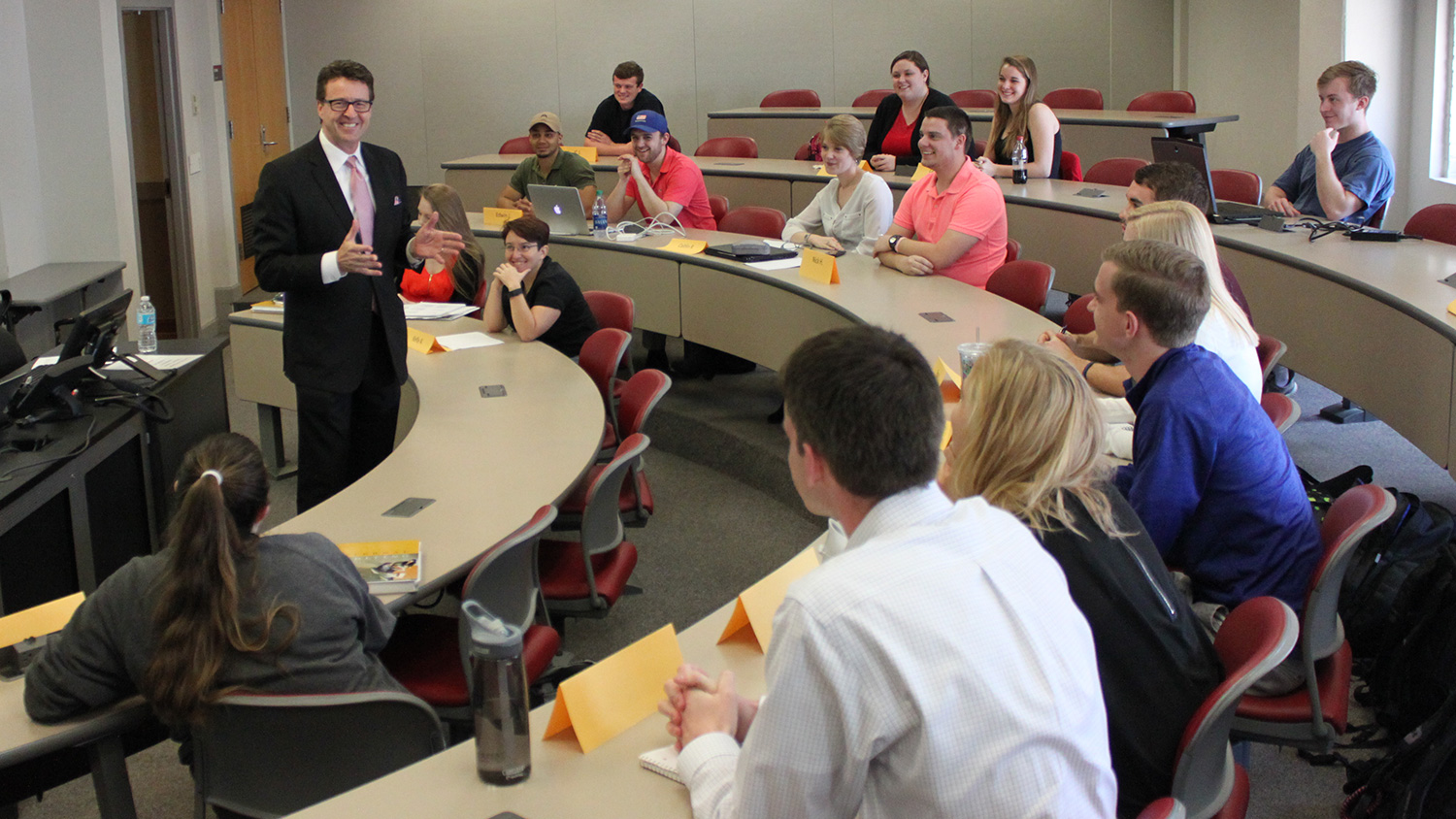 Photo of guest speaker Scott McKay discussing accounting fraud with students in Dr. Al Chen's accounting course.