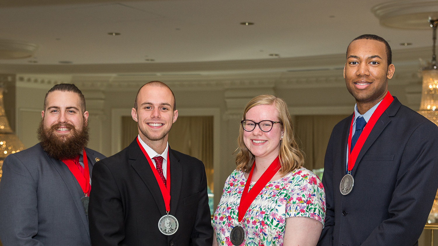 Photo of NC State Student Alumni Association Student Awards recipients from left to right, Justin Rigdon, Hunter Davis, Mary Chamblee, and Tyrek Shepard.
