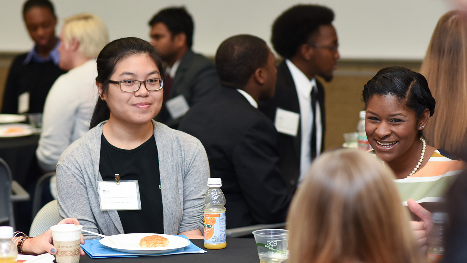 Students and recruiters discuss diversity and inclusion in the workplace at this breakfast meeting.