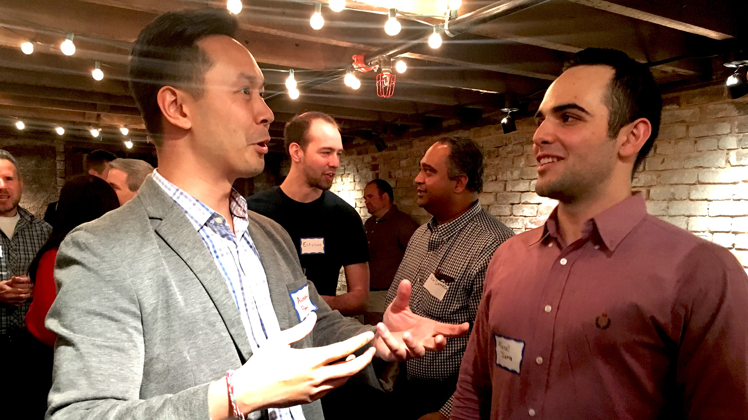 Andrew Poon, left, in discussion at an NC State Entrepreneurship mentor-student networking event.