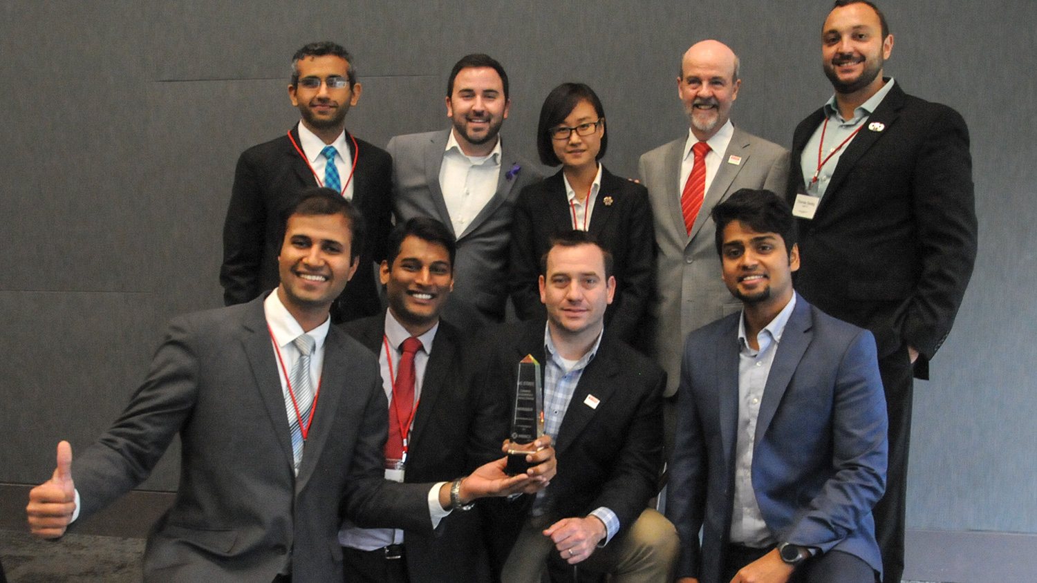 Photo of First place Boston University Questrom School of Business MBA students with their NC State Jenkins MBA 'assist' team