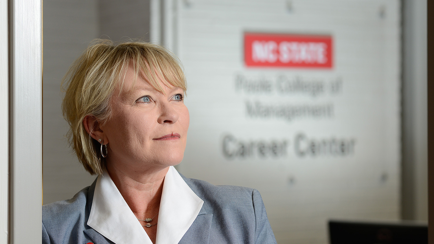 Annette L. Ranft, Poole College's fourth dean, at doorway to the college's Career Center.