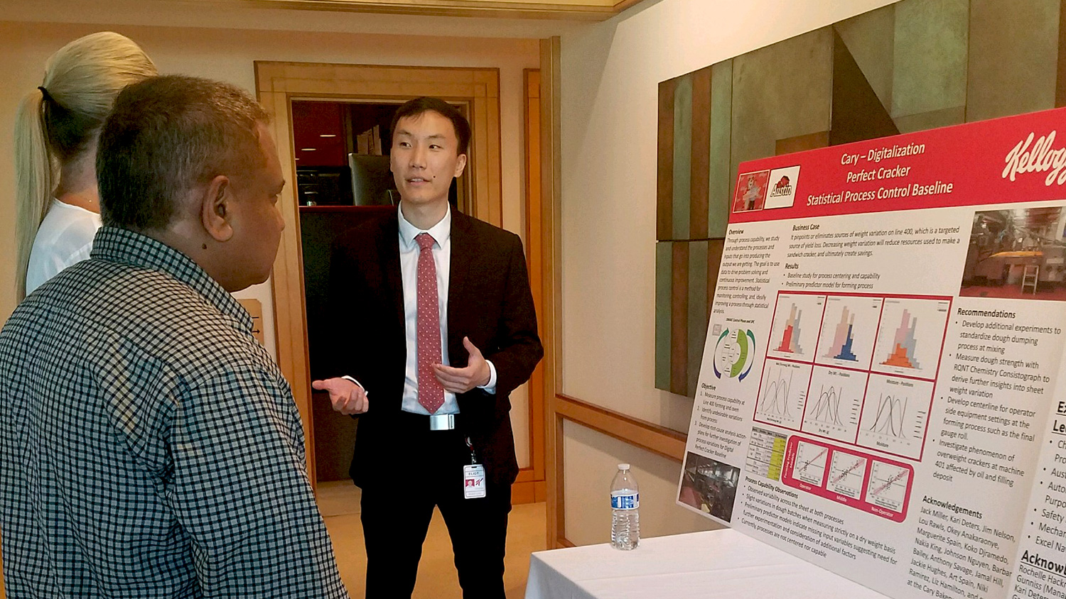 Eliot Lee explains his project during Kellogg's internship showcase.
