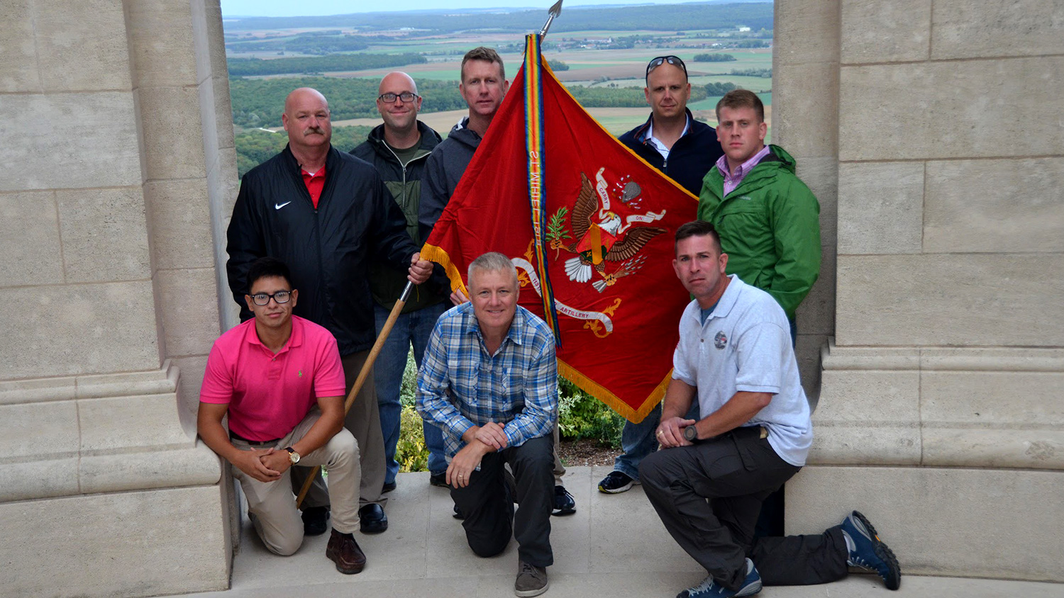 While en route to a ceremony commemorating the 1918 Meuse-Argonne offensive in northeastern France, NC State Army Reserve members stopped at the Montsec American Monument in France, which honors the 1918 Battle of Saint-Mihiel in which their unit fought during WWI. They are holding their 113th Field Artillery Regiment flag.