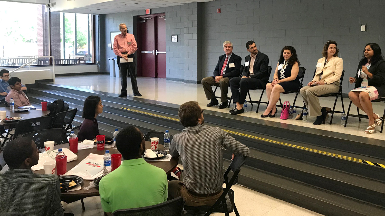 Accounting professionals and students discuss accounting career paths at 2019 NCACPA Leadership Conference at NC State University. Panelists, left to right, are David Erwin, NC Department of State Treasurer; Jared Korver, Beacon Wealthcare; Amy Hilliard, Dixon Hughes Goodman; Alice Mariano, NC Farm Bureau Mutual Insurance Company; Abi Raja, Ply Gem.