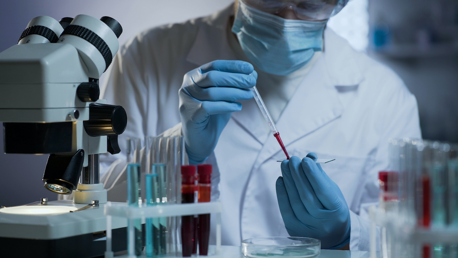 Researcher,Conducting,Blood,Test,At,Modern,Medical,Laboratory,,Health,Care