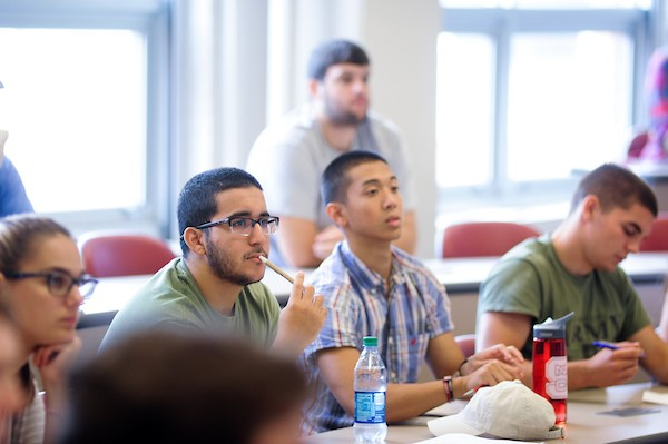 Consult Your Community members show their NCState pride at a meeting this past year.
