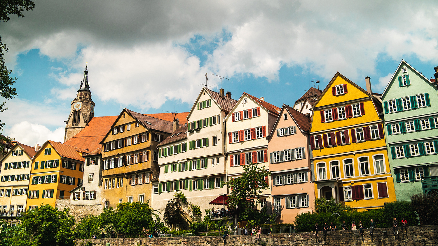 A row of European-style houses on a river