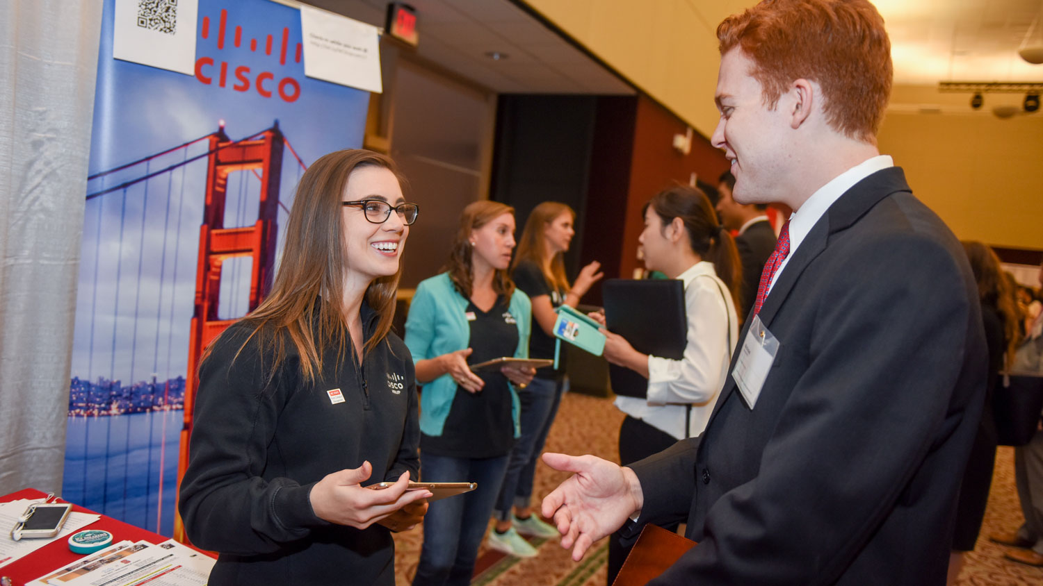 Student talking to recruiter at career fair